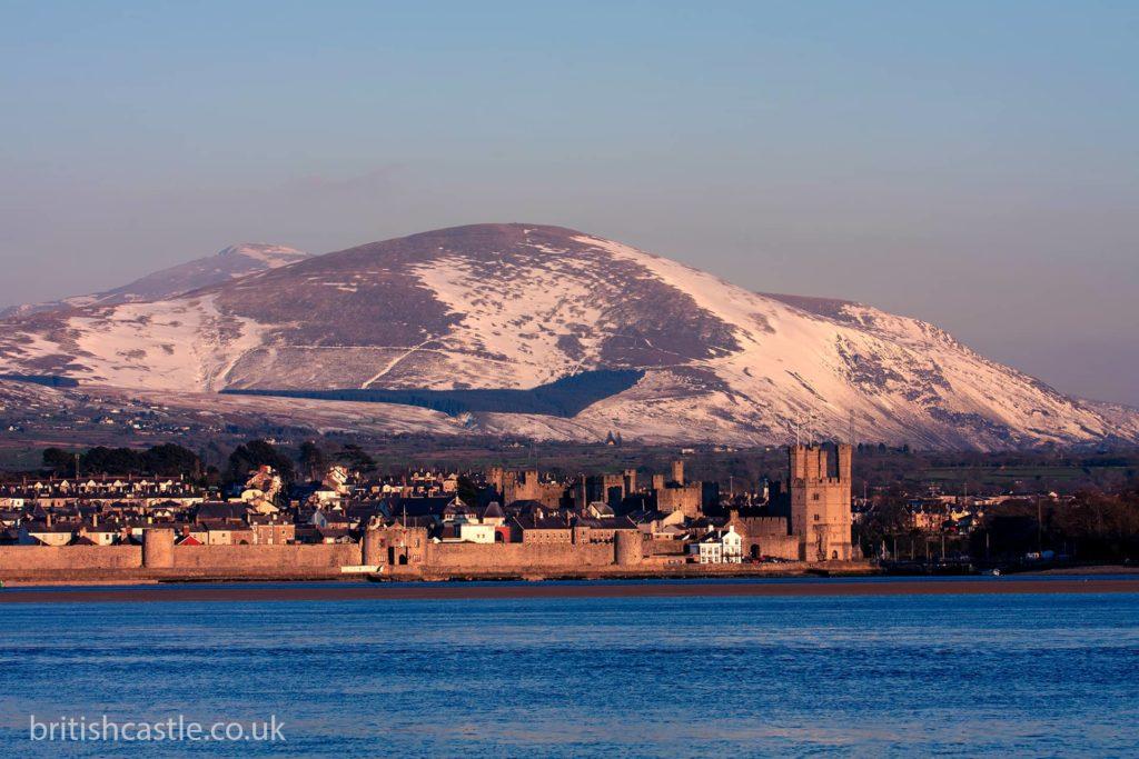 Caernarfon overlooked by a snowy Snowdon