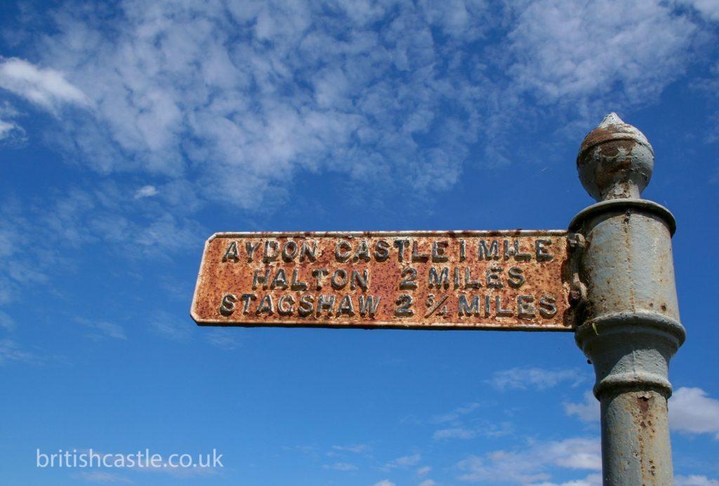 Old rusty street sign to Aydon Castle